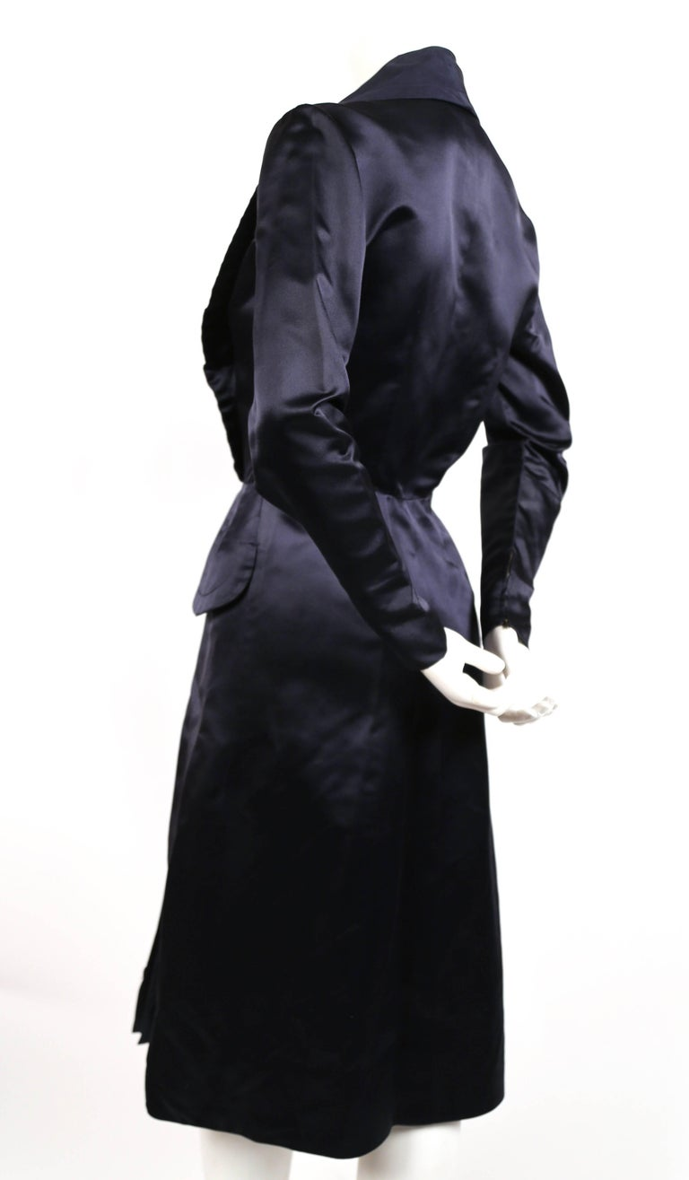 Very rare navy satin coat dress designed by Jacques Fath for Joseph Halpert dating to the 1940's. Best fits a size 4. Approximate measurements: shoulders 15