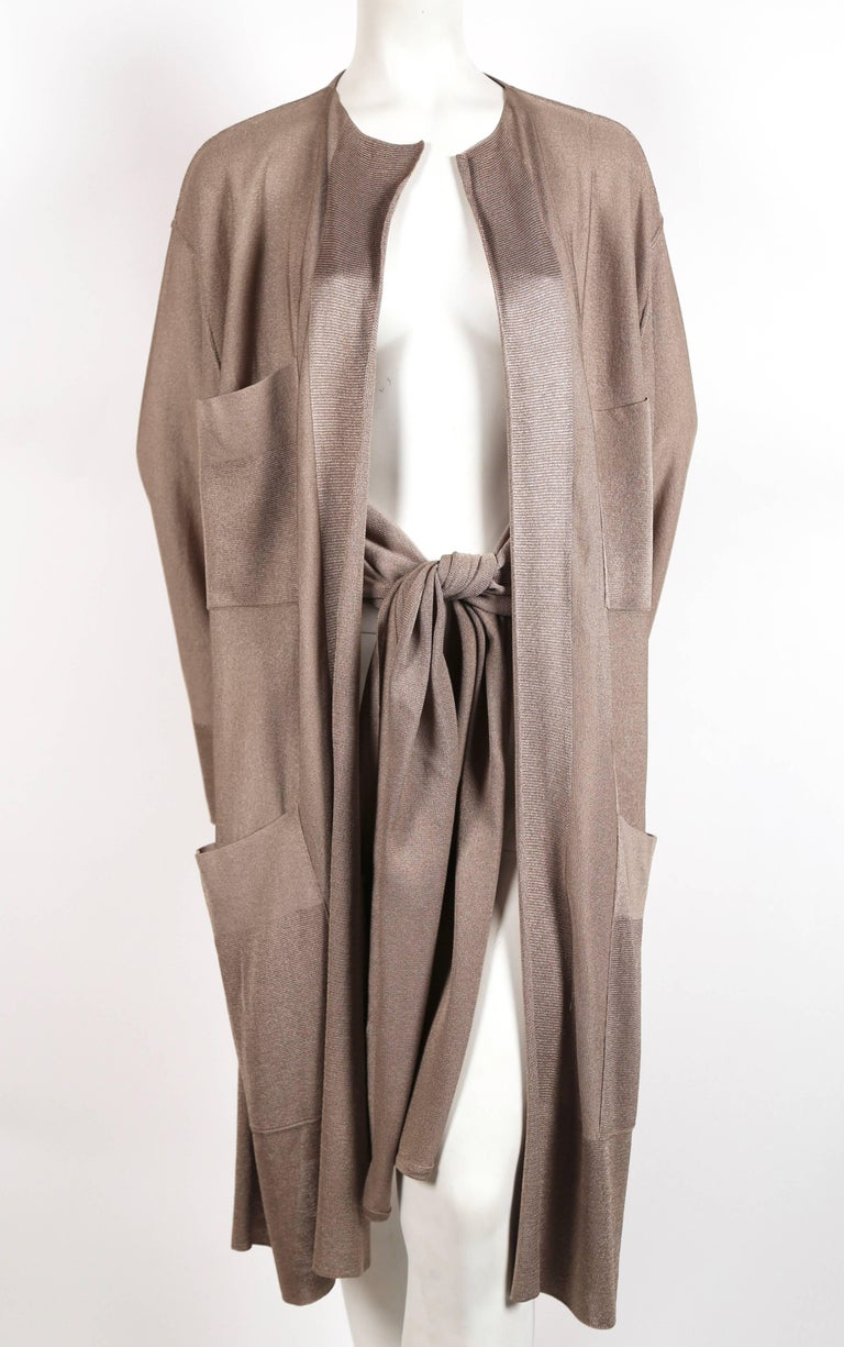Taupe knit jacket with waist ties designed by Azzedine Alaia dating to the 1980's. Labeled a size Medium. Approximate measurements laying flat: shoulder 20