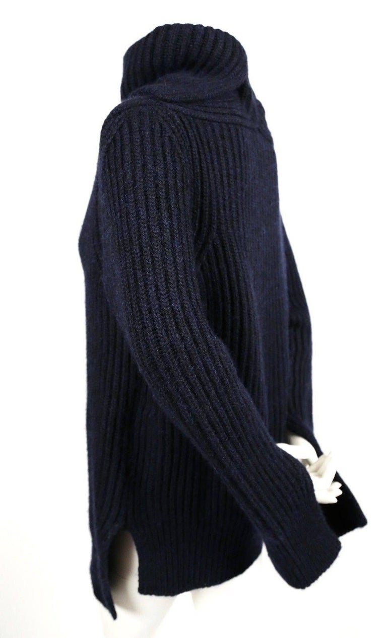 Oversized soft and fuzzy oversized navy blue cashmere and mohair sweater designed by Phoebe Philo for Celine.  This thick sweater has a split neck and split sleeves for an interesting fit. Labeled a French size S however the intended fit is very
