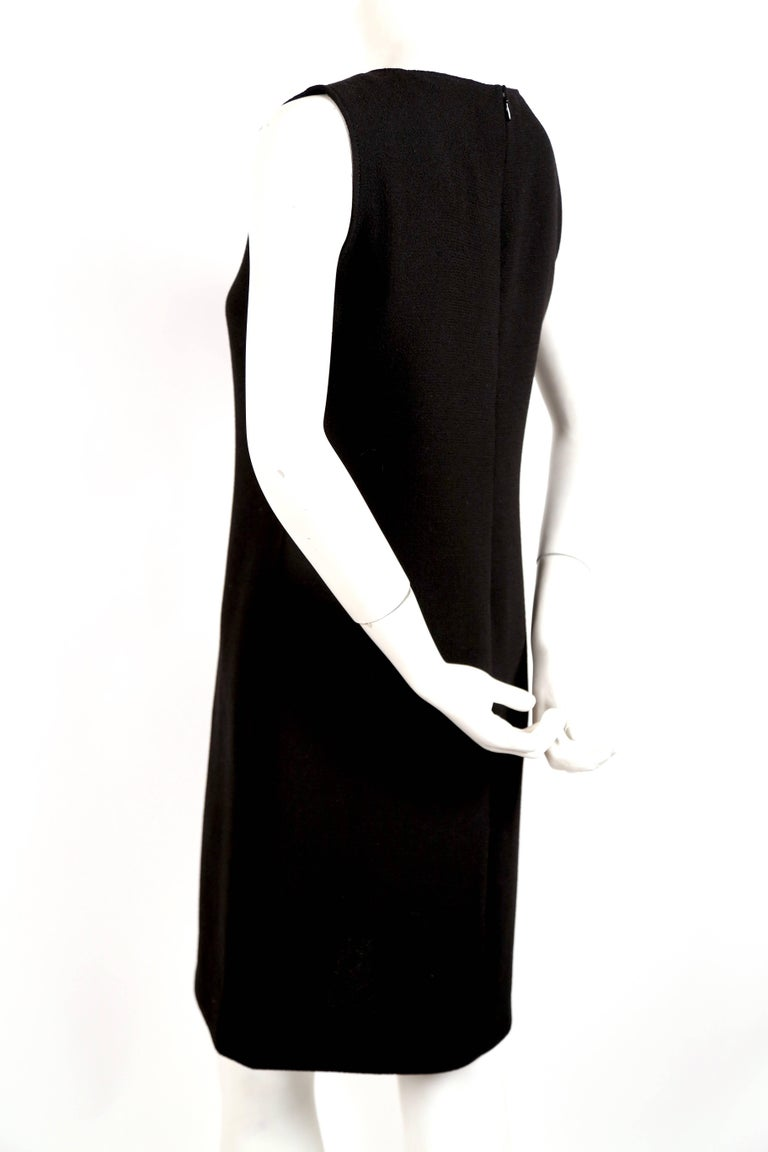 Black Pierre Cardin haute couture wool dress with circular cut outs, 1970s  For Sale