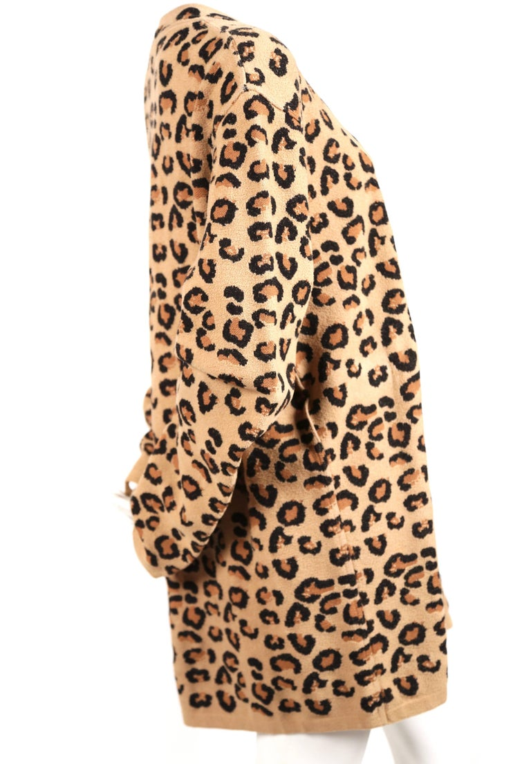 """Extremely rare oversized V-neck woven leopard knit tunic dress from Azzedine Alaia dating to fall of 1991. Labeled a size S. Approximate un-stretched measurements: shoulders 21"""", bust 50"""", hem width 46"""", arm length (un-cuffed)"""