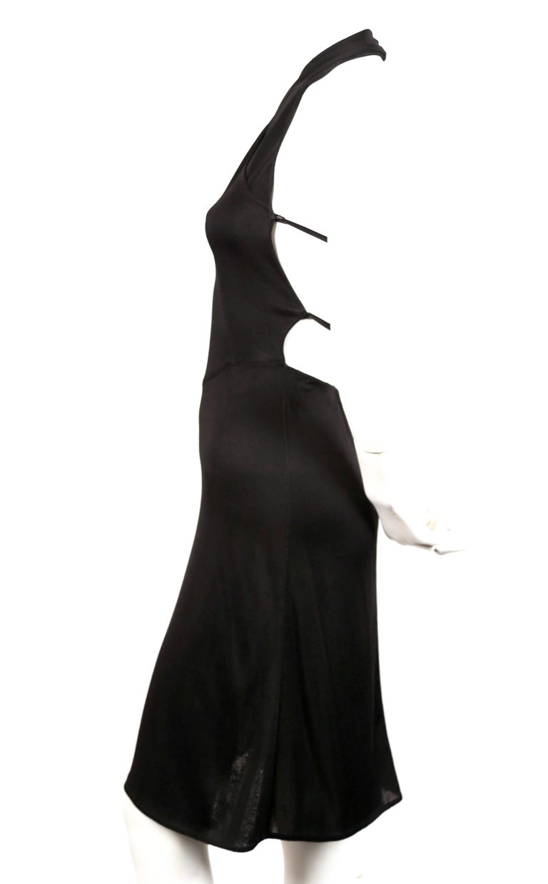 Very rare jet-black halter style dress designed by Azzedine Alaia dating to the 1990's.  Labeled a size 'XS'. Waist measures approximately 23