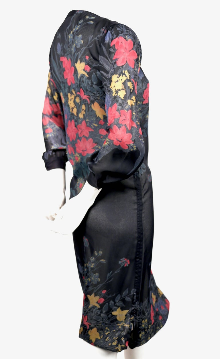 Semi-sheer, silk, floral printed dress with asymmetrically placed button collar and drawstring hemline deigned by Sonia Rykiel dating to the late 1970's. Fits a US 2 (34