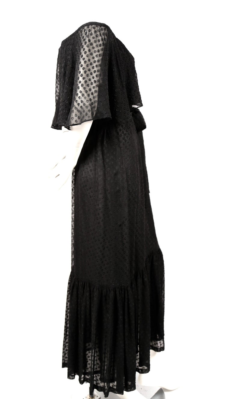 Black off-the-shoulder peasant dress with woven abstract pattern and matching belt from Yves Saint Laurent dating to the 1970's. Dress is labeled a French size 38, however it best fits a modern French 36 or 38 or US 2-6. Approximate measurements: