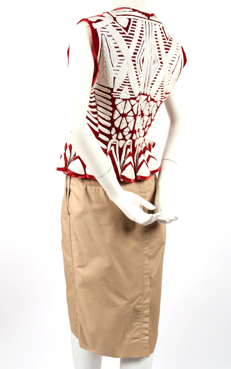 Very rare, claret velvet peplum jacket with embroidery and matching tan pencil skirt designed by Tom Ford for Yves Saint Laurent exactly as seen on the runway for Spring 2002. Both pieces are labeled a French size 40. Jacket measures approximately: