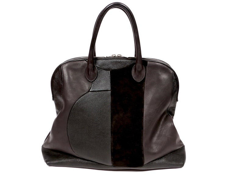 Black bowling style bag featuring different types of leather and suede in a patchwork motif designed by Phoebe Philo for Celine circa 2010. Approximate measurements: 17.5