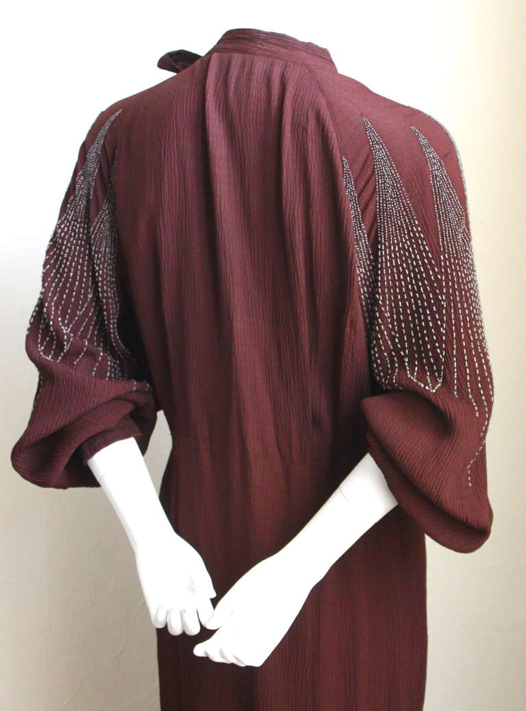 Black 1930's MAINBOCHER oxblood crepe dress with beaded sleeves For Sale