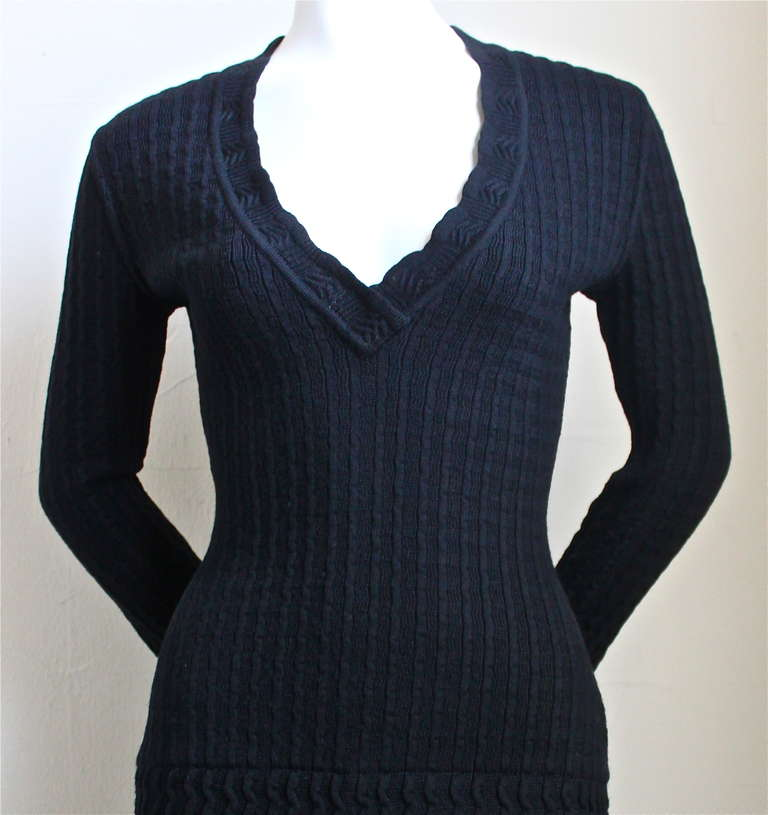 "Classic jet black knit wool dress with crocheted detail from Alaia dating to the 1990's. Size 'S'. Approximate measurements: bust 32"", waist 22"", hips 32' and length is 33"" - however the knit is very soft and stretchy so this dress"