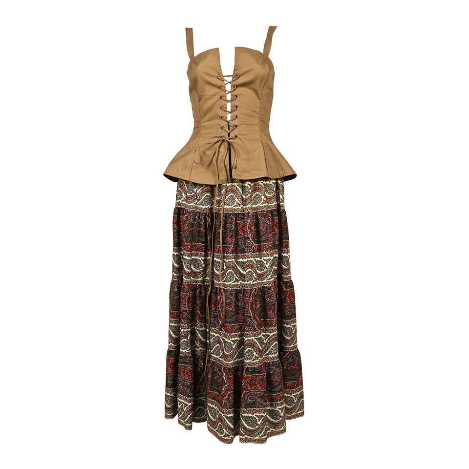 1977 YVES SAINT LAURENT lace up bustier with tiered floral paisley skirt For Sale