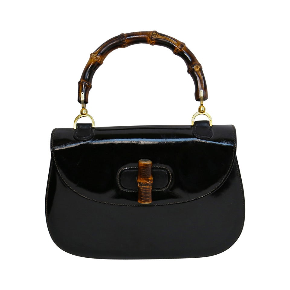 1975 GUCCI black patent leather bag with bamboo handle For Sale