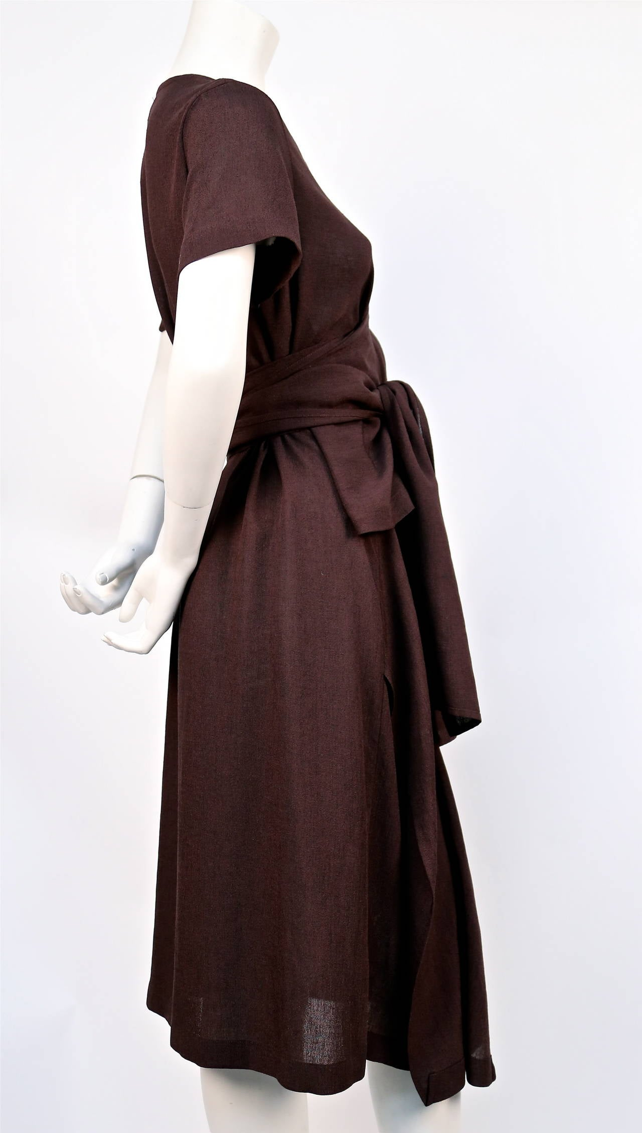 Very unusual brown draped dress with wrap waist from Comme Des Garcons 'tricot' dating to 1997. No size is indicated although this would best fit a size XS or S. Made in Japan. Excellent condition.