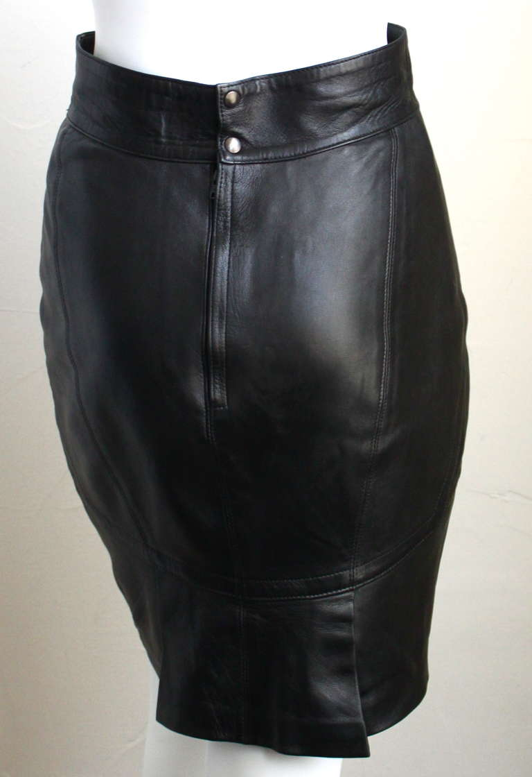 "Jet black butter soft leather skirt with seaming and pleated hemline from Azzedine Alaia dating to the 1990's. French size 40 although this skirt is very small and best fits a US 4. Approximate measurements: waist 26"", hips 35"" and length 21""."