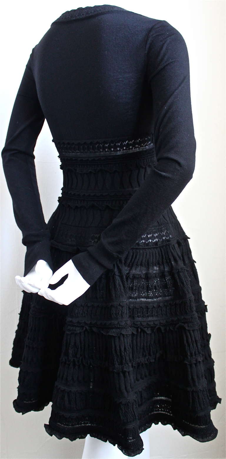 """Very rare jet black lightweight wool dress with intricately woven lace panels from Azzedine Alaia. Dress is labeled a size 'S'. Slips on over the head. Approximate unstretched measurements are:  bust 30"""", waist 27"""", open hips, and the length is 35""""."""