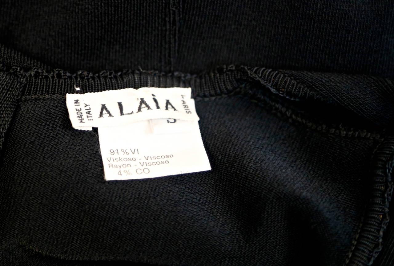Black 1990's AZZEDINE ALAIA black sleeveless dress with ruffled hemline For Sale