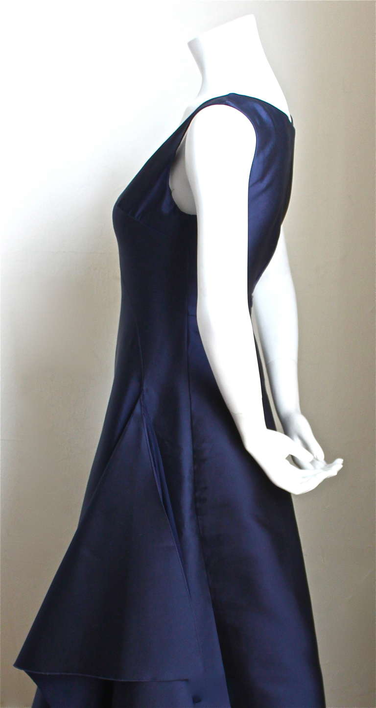 Rich navy blue silk gown with asymmetrical swag from Balenciaga le dix exactly as seen on the runway in spring of 1996. Dress is labeled a French size 38, however it is very slim through the chest and best fits a size 2. Approximate measurements: