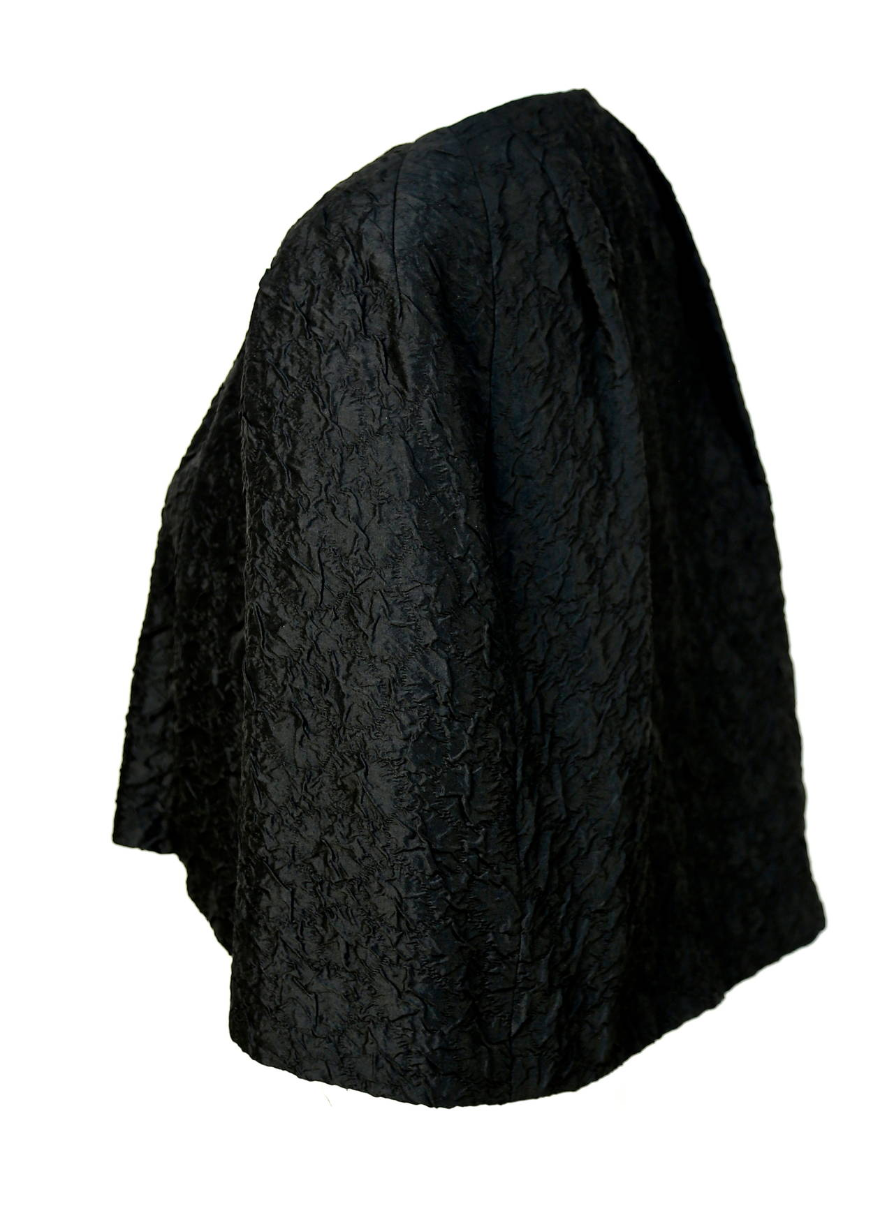 "Very rare jet black haute couture silk capelet from Cristobal Balenciaga for Eisa dating to the 1960's. Fits a size small or medium best. Approximate measurements: length in front 15.75"" and length in back 20"". Made in Spain. Single hook/eye"