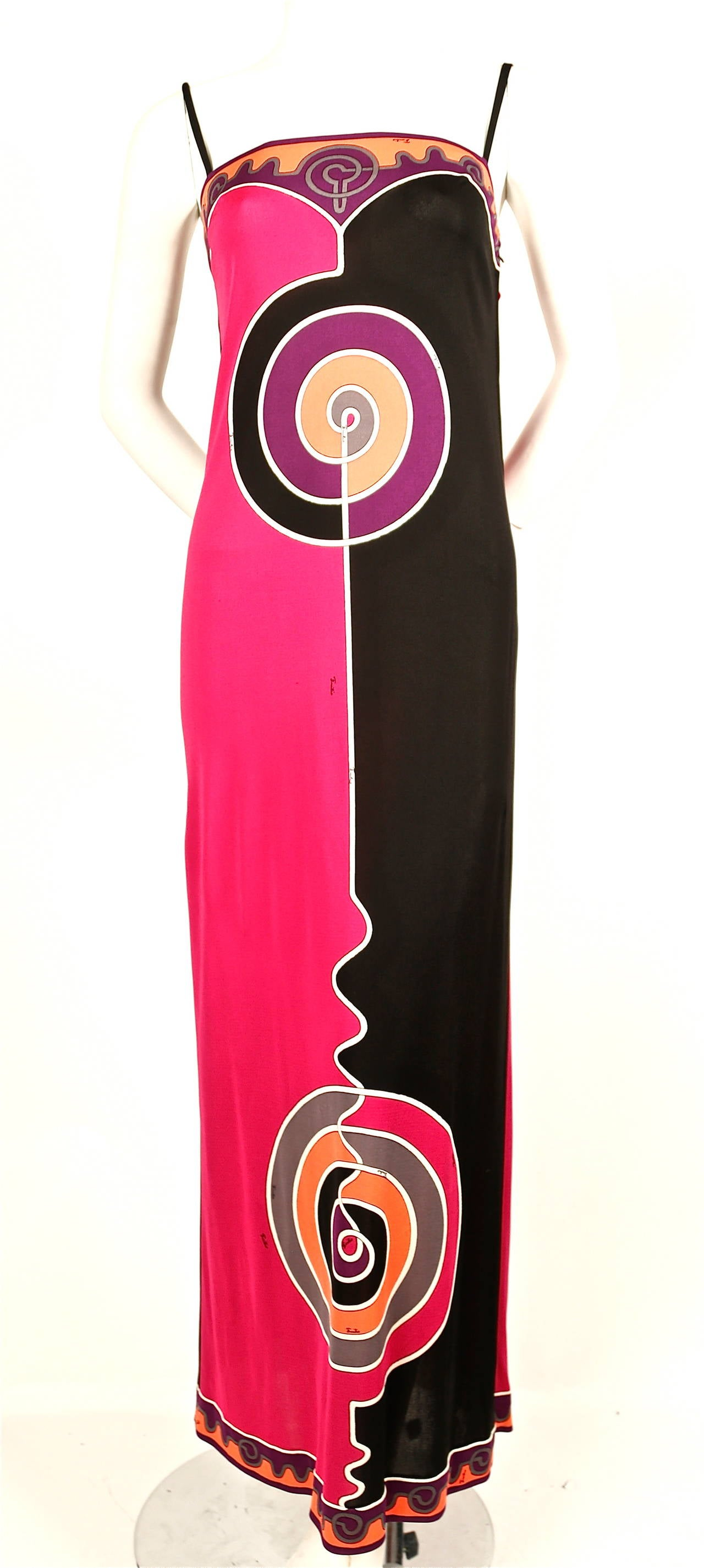Vivid printed silk jersey spaghetti strap dress from Emilio Pucci dating to the late 1960's, early 1970's. Labeled a size 6 however this would best fit a modern size 2. Approximate measurements: bust 31.5-32