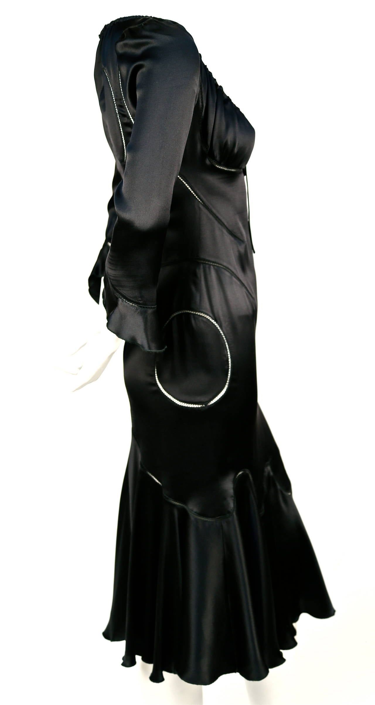 Very rare jet black silk charmeuse dress with open stitched seaming created by Alexander McQueen for the Fall 2002 'Supercalifragilisticexpialidocious' runway collection. No size is indicated although this dress best fits a size 2 or 4. Approximate