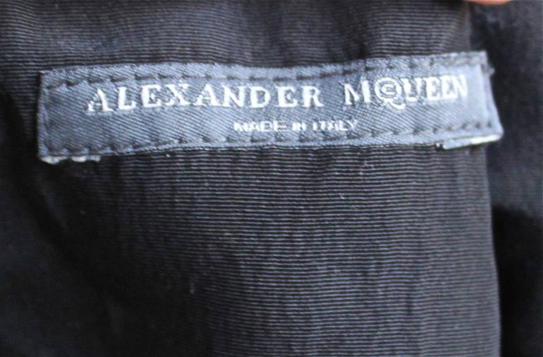 Black 2003 ALEXANDER MCQUEEN black taffeta dress with pleated hemline trimmed in fur For Sale
