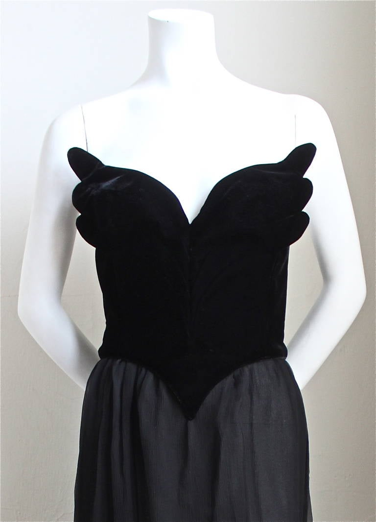 "Very rare jet black velvet winged bustier with sheer silk skirt and structured jacket from Thierry Mugler dating to 1988. Labeled a French size 38.  Bustier measures approximately 33"" at bust and 26"" at waist. Skirt measures 26"" at waist and is 42"""