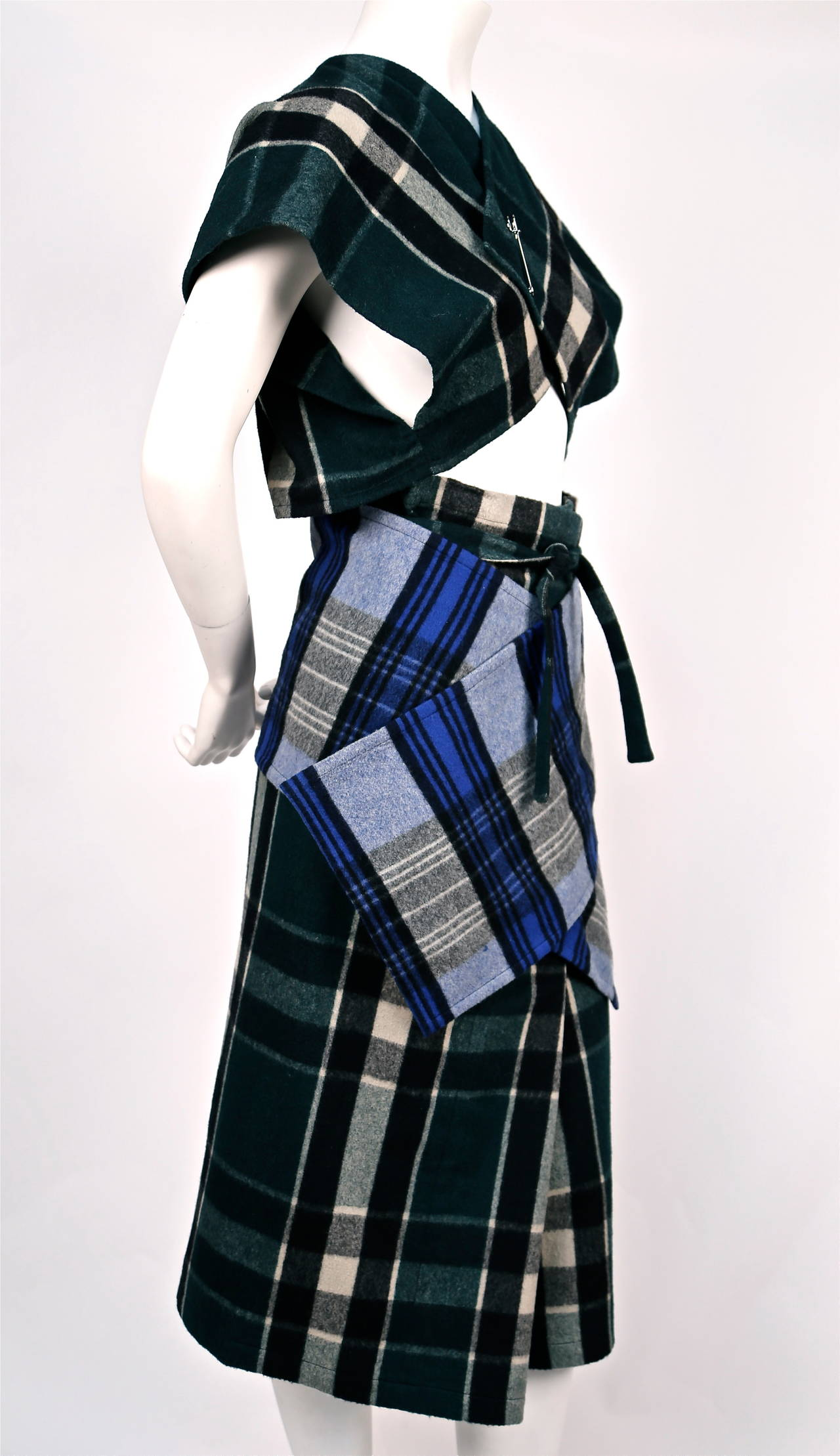 very rare plaid wool ensemble from COMME DES GARCONS dating to the early 1980's. Very rare to have matching set from this era. No size is indicated however the sizing is flexible. This set can fit up to a size 6 or 8. Shown on a size 2 mannequin