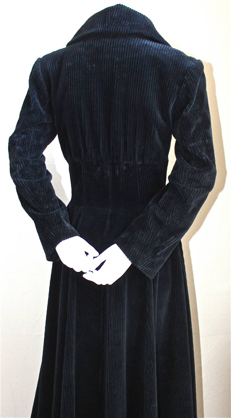 "Very rare midnight blue wide wale velvet coat with corset waist from Azzedine Alaia dating to the late 1980's. Coat is labeled a French 38 which best fits a size 4. Approximate measurements: shoulders 16"", bust 34"", waist 27-28"", arm length 23"" and"
