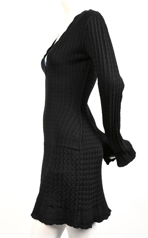 Classic jet black knit wool dress with crocheted detail from Alaia dating to the 1990's. Size 'S'. Approximate measurements: bust 32