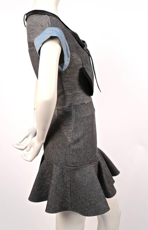 Very rare grey wool patchwork dress with denim and leather trim designed by Nicolas Ghesquière for Balenciaga exactly as seen on the fall 2002 runway. Labeled a French 40 however this would best fit a French 38. Side zip entry. Made in France.