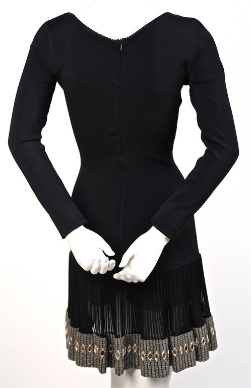 Azzedine Alaia black mini dress with mirrored hemline, 1990s  In Excellent Condition For Sale In San Fransisco, CA