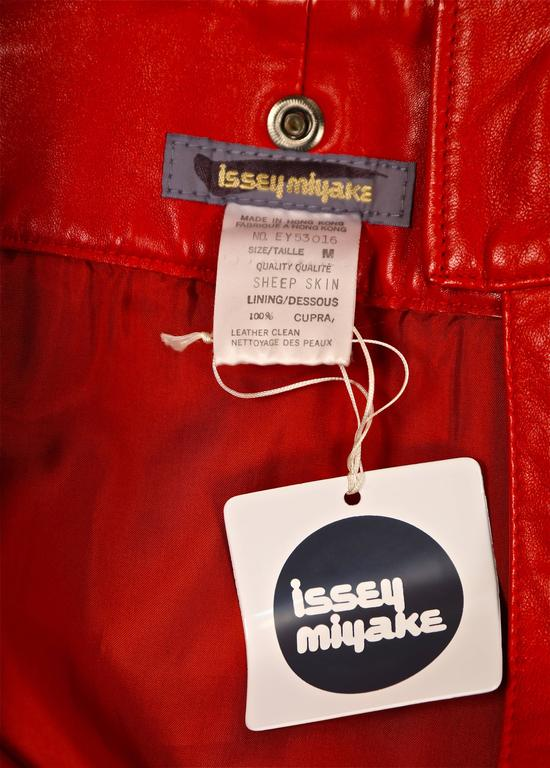 unworn 1980's ISSEY MIYAKE red leather mini skirt with oversized studs 2