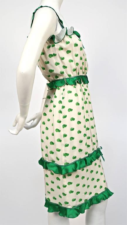 "Green and off-white abstract printed silk dress with ruffles from Andre Courreges dating to the 1973. Labeled a Courreges '00' which fits a size 0/2. Approximate measurements: bust 30"", waist 24"", hips 38"" and length 40"". Zips up"
