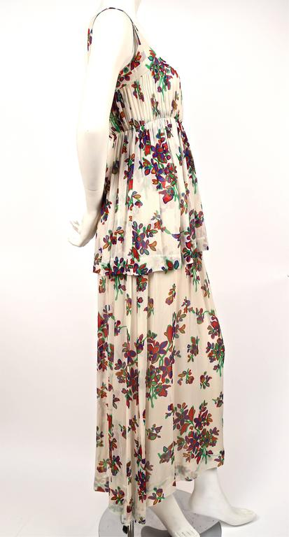 "Delicate floral silk chiffon summer dress designed by Yves Saint Laurent dating to the 1970s. Best fits a size 4 or 6. Approximate measurements: bust 32-33"", waist 26.5-27"" and length 53-54"". Fully lined in cream silk. Zips up center"