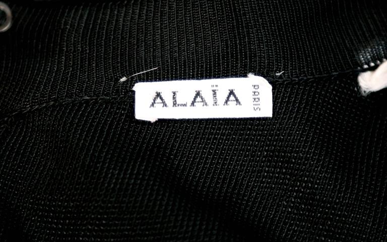 Women's or Men's 1992 Azzedine Alaia documented black dress with sheer asymmetrical hemline For Sale