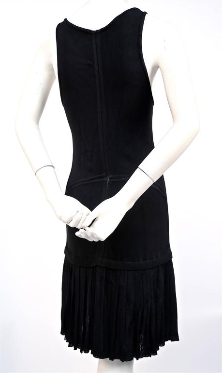 Black 1990's AZZEDINE ALAIA black knit dress with pleated skirt For Sale