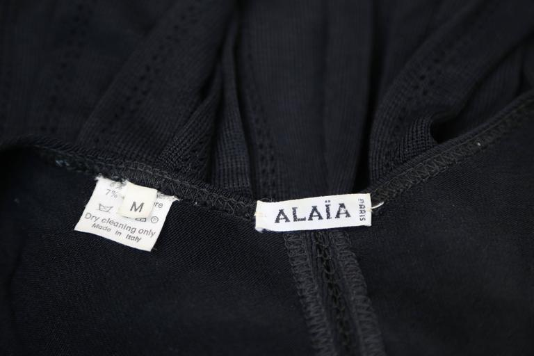 1990's AZZEDINE ALAIA black knit dress with pleated skirt In Good Condition For Sale In San Fransisco, CA