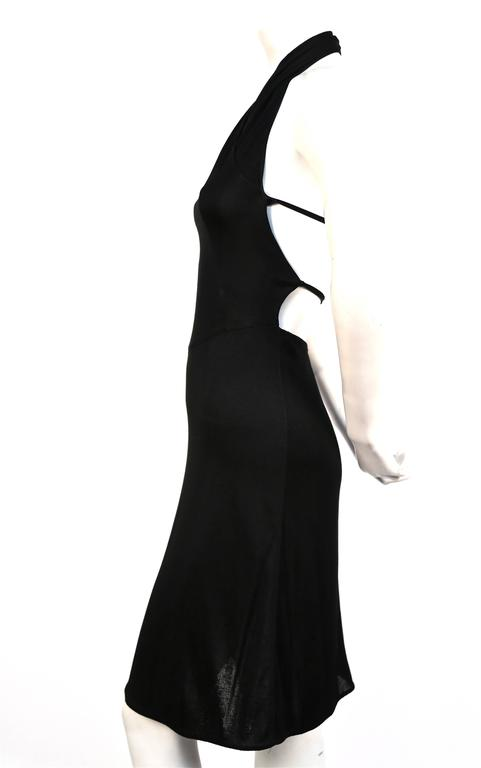 Very rare jet black halter dress from Alaia dating to the 1990's. Absolutely stunning shape. Labeled a size 'XS'. Approximate measurements (unstretched): bust 26-28