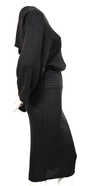 "Very rare soft black linen dress with elasticized waist and cut out back from Azzedine Alaia dating to the 1980's. Size 'S'. Approximate measurements: drop shoulder 20"", waist 24"" (stretches), hips 32"" (stretches), arm length 18.5"" and overall"