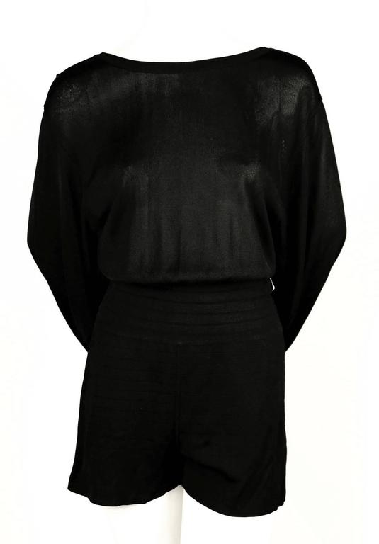 Jet black summer playsuit with matching skirt that cleverly hooks onto waistband to create a unique draped silhouette designed by Azzedine Alaia dating to the late 1980's. Looks great worn during day or night. Would be a wonder travel piece. Labeled