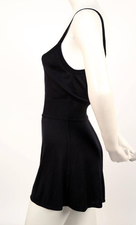 """Black romper with set in woven waistband designed by Azzedine Alaia. French size 36 (best fits a FR 38 or tall FR 36). Approximate measurements: bust 30"""", waist 23"""", hips 36"""", length from top of straps to bottom of waistband 18"""", length from bottom"""