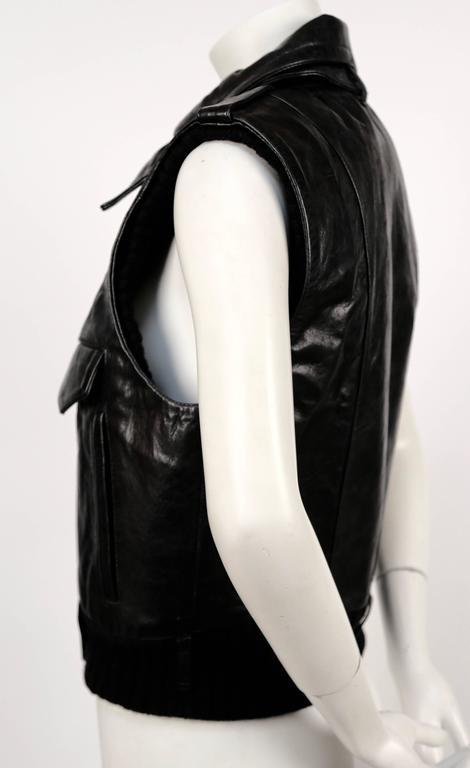 Very rare documented leather vest with wool trim designed by Nicolas Ghesquière for Balenciaga as seen on the runway for fall of 2002. Labeled a French size 40. Approximate measurements: shoulder 15