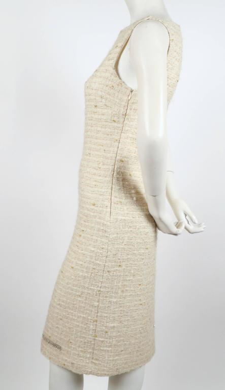 "Classic cream boucle sheath dress with unique chainmail detail designed by Genny. Italian size 42. Approximate measurements: bust 33-34"", waist 30"", hips 37-38"" and length 40"". There is some give to the material. Fully lined in silk. Side zip entry."