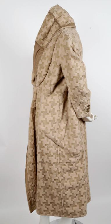 Incredible cream and brown woven houndstooth draped wool coat from Comme Des Garcons. Appears as a coat worn over another coat in classic 'visual pun' form from CDG. Exact coat as seen on runway. Can be worn numerous ways. Labeled a size 'M' however