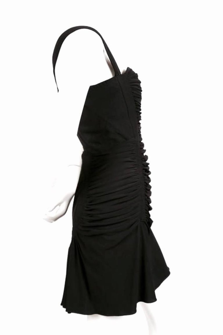 Jet black shirred dress with open back and intricate topstitching from Azzedine Alaia. Very clever construction at back. Dress best fits a US size 6. Approximate measurements: bust 34