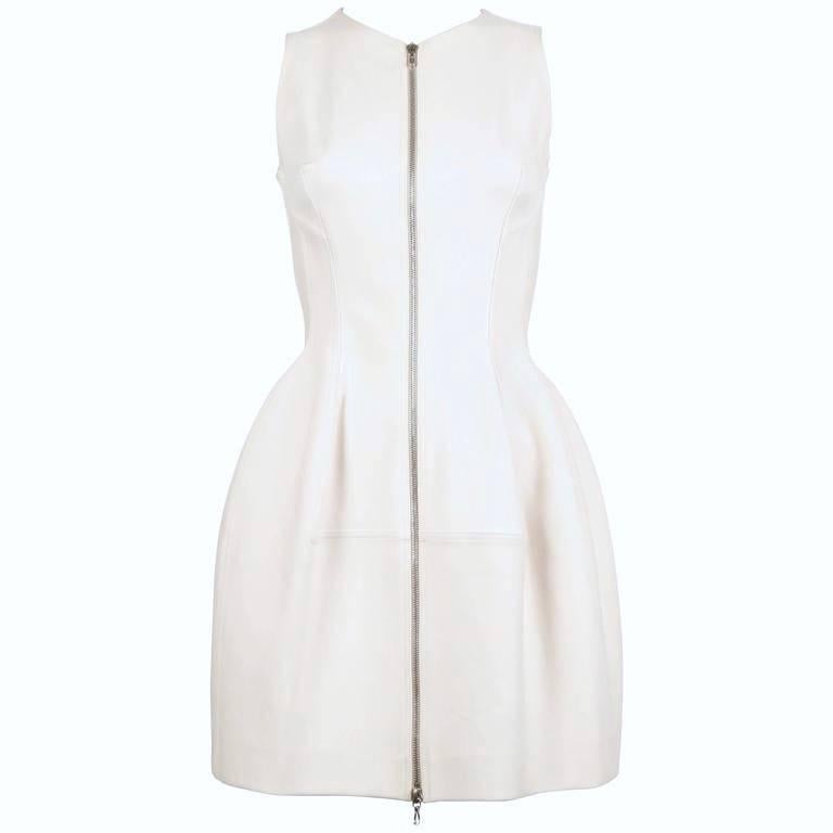 """Gorgeous cream tulip shaped dress with silver toned two-way zipper from Azzedine Alaia. No size is indicated however it best fits a size 4 or slim 6 (33"""" max bust). Approximate measurements: bust 32"""", waist 26.5"""" and length 33""""."""