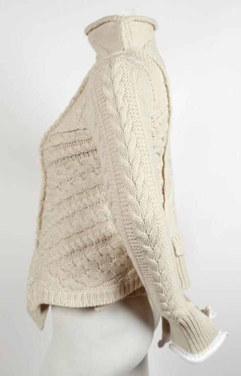 Beige rare CELINE by PHOEBE PHILO wool cable knit sweater with asymmetrical hem For Sale