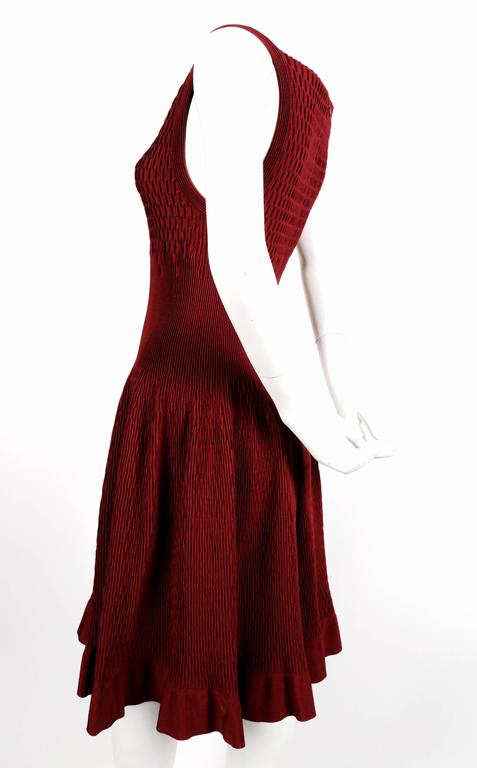 Bordeaux knit dress with intricate woven details from Azzedine Alaia. New with tags. French size 40. Approximate measurements (unstretched): bust 24