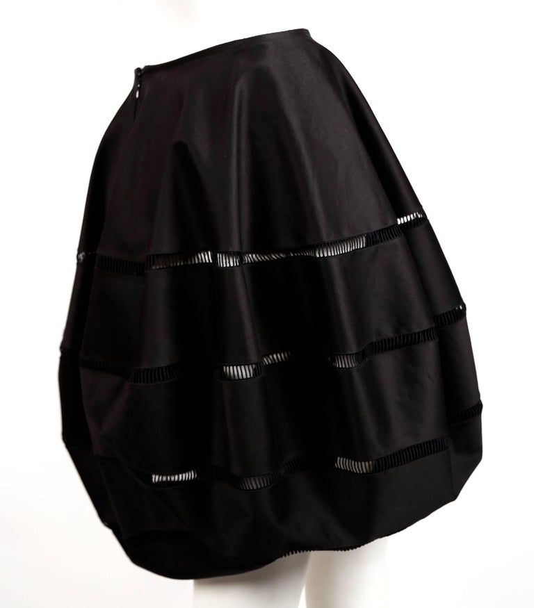 Black polished cotton bubble skirt with embroidered cut outs designed by Azzedine Alaia. Best fits a US size 2-4. Approximate measurements: waist laying flat 25