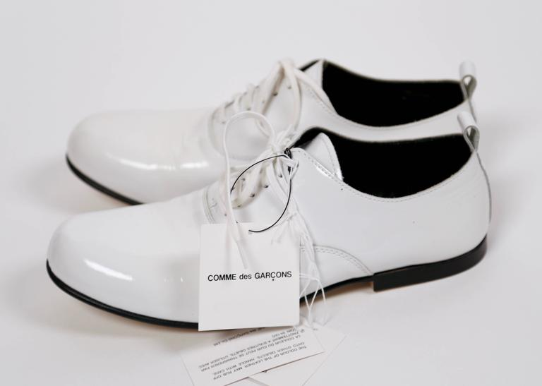 74ae6df57f22 Unworn white patent leather oxfords from Comme Des Garcons dating to the  fall 2007-2008