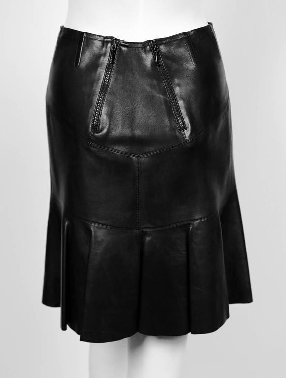 azzedine alaia black leather skirt with pleated hemline