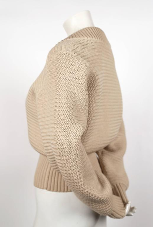 "Off-white, densely knit wool cardigan sweater jacket with brass zippers and ribbed trim from Azzedine Alaia dating to fall of 1985. Size 'S'. Approximate measurements: drop shoulder 19"", bust 40"", waist (un-stretched) 22"", arm length 25"" and overall"